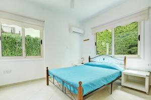A bed or beds in a room at Crystal Sea Villa