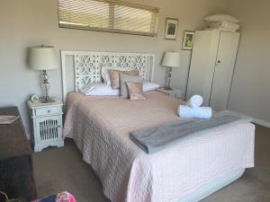 A bed or beds in a room at Rockpool
