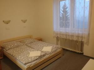 Кровать или кровати в номере Hotel M&M