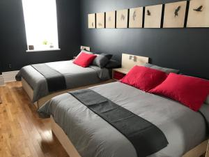 A bed or beds in a room at Le Gite