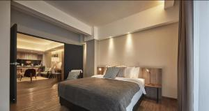 A bed or beds in a room at Tropics Eight Suites
