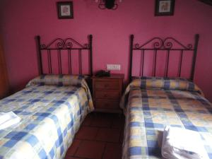 A bed or beds in a room at Hostal Venta Liara