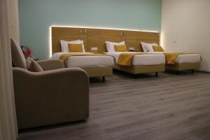 A seating area at Hotel Império do Norte