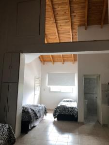 Una cama o camas en una habitación de Ruffus's Apple