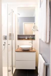 A bathroom at Boutique Hotel Splendid-Dollmann