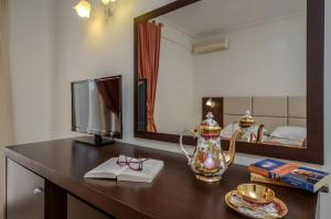 A television and/or entertainment center at Aeolis Boutique Hotel