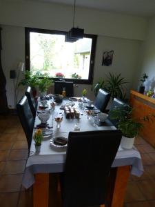 Restaurant ou autre lieu de restauration dans l'établissement LES CHAMBRES DU GAVE D'OSSAU
