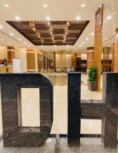 O saguão ou recepção de Dar Hashim Hotel Suites - Alnuzha