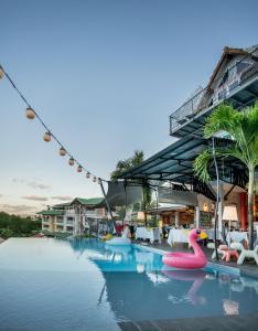 The swimming pool at or near La Suite Villa