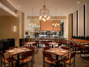A restaurant or other place to eat at Mint House at 70 Pine