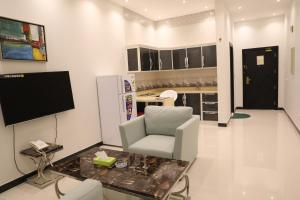 Uma TV ou centro de entretenimento em Quiet Rooms Suites