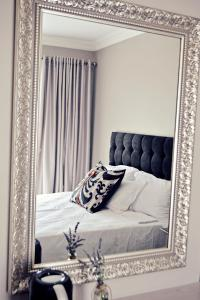 A bed or beds in a room at Bokmakierie Gastehuis Emalahleni Pty Ltd