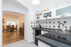 A kitchen or kitchenette at Budyne Apartment II.