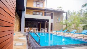 The swimming pool at or close to Hiriketiya Beach Resort