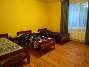 Кровать или кровати в номере Guest house on Ilushkina 5