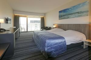 Een bed of bedden in een kamer bij Vayamundo Oostende