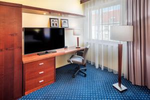 A television and/or entertainment center at Courtyard by Marriott Prague City