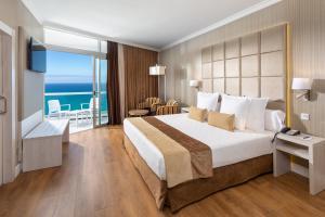 Un ou plusieurs lits dans un hébergement de l'établissement Hotel Best Semiramis