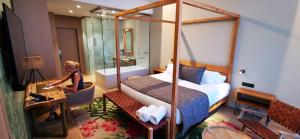 A bed or beds in a room at Tropical Beach Boutique Hotel-Singular's Hotels