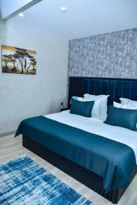 Cama ou camas em um quarto em Supreme Hotel Baku