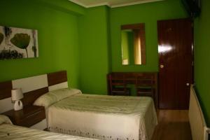 Cama o camas de una habitación en Hotel Restaurante Valdevenados