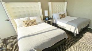 A bed or beds in a room at Bentley Hotel
