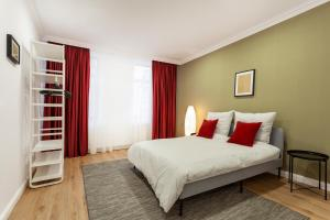 A bed or beds in a room at Martin Boutique Hotel