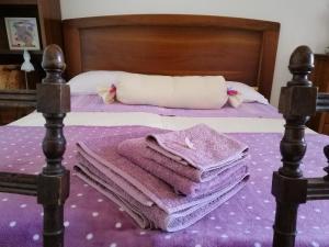 Letto o letti in una camera di Amor di Lavanda