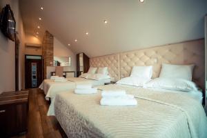 Cama o camas de una habitación en Golden Lakes Rooms