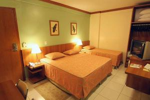 A bed or beds in a room at Golden Dolphin Express