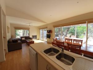 A kitchen or kitchenette at Waterfront Retreat At Wattle Point