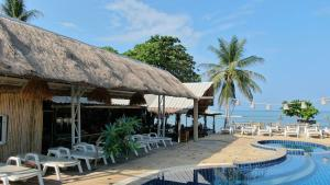 The swimming pool at or near Lanta New Coconut Bungalow - SHA Plus