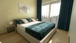 Voodi või voodid majutusasutuse Rotermanni Premium Apartment toas