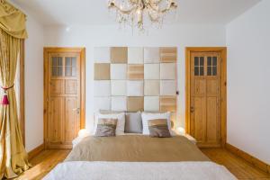 Een bed of bedden in een kamer bij B&B Azee