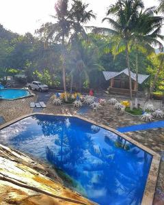 The swimming pool at or near Quilombo Hotel Fazenda