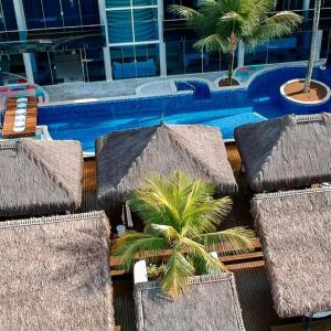 A piscina localizada em Residência Angra Deep Blue ou nos arredores