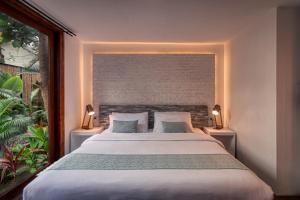 Ein Bett oder Betten in einem Zimmer der Unterkunft The Box - Lipe Resort