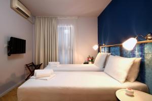 Ένα ή περισσότερα κρεβάτια σε δωμάτιο στο Panonija