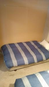 A bed or beds in a room at Chise House