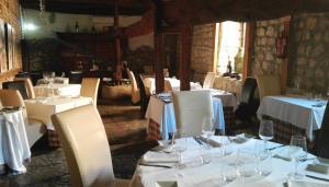 Un restaurante o sitio para comer en La Casa del Abad