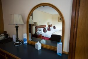 A bed or beds in a room at Whitewater Hotel & Spa