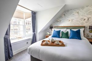A bed or beds in a room at Blackfriars