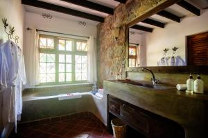 A bathroom at Rivertrees Country Inn
