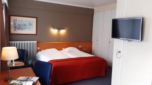 Een bed of bedden in een kamer bij Hotel Lido