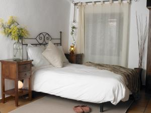 A bed or beds in a room at Can Marc