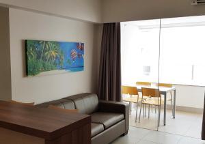 Uma área de estar em Enjoy Olimpia Park Resort