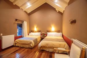 A bed or beds in a room at Tambo del Arriero Hotel Boutique