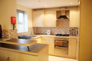A kitchen or kitchenette at Brunel Crescent Apartments