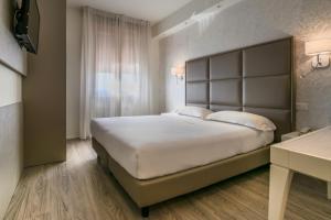 Letto o letti in una camera di Hotel Globo