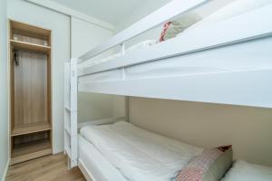 Een stapelbed of stapelbedden in een kamer bij De Herberg Appartementen